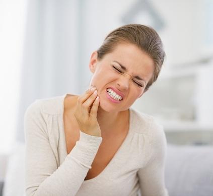 Những dấu hiệu cơ bản khi mọc răng khôn và cách xử lí 1
