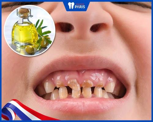 Trị xiết răng bằng dầu oliu cho trẻ