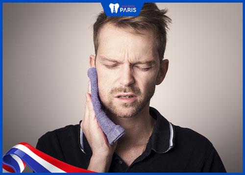 Nhổ răng khôn hơn 10 ngày vẫn đau