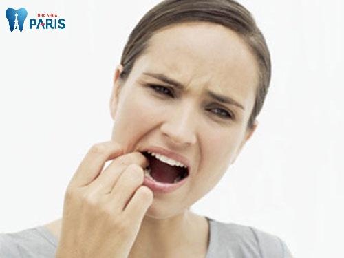 răng hàm lung lay có nên nhổ không